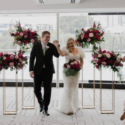 WeddingnFloristBrisbaneTall GOld flower stands ceremony backdrop