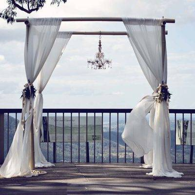 wedding arbour with white draping
