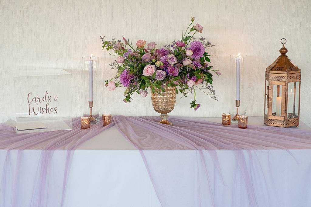 Lavender and rose gold wishing well table styling
